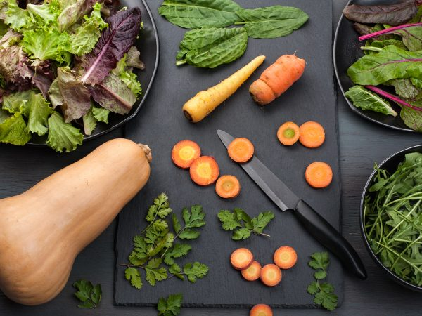 Carrots, winter squash, and dark leafy greens rich in iron for babies