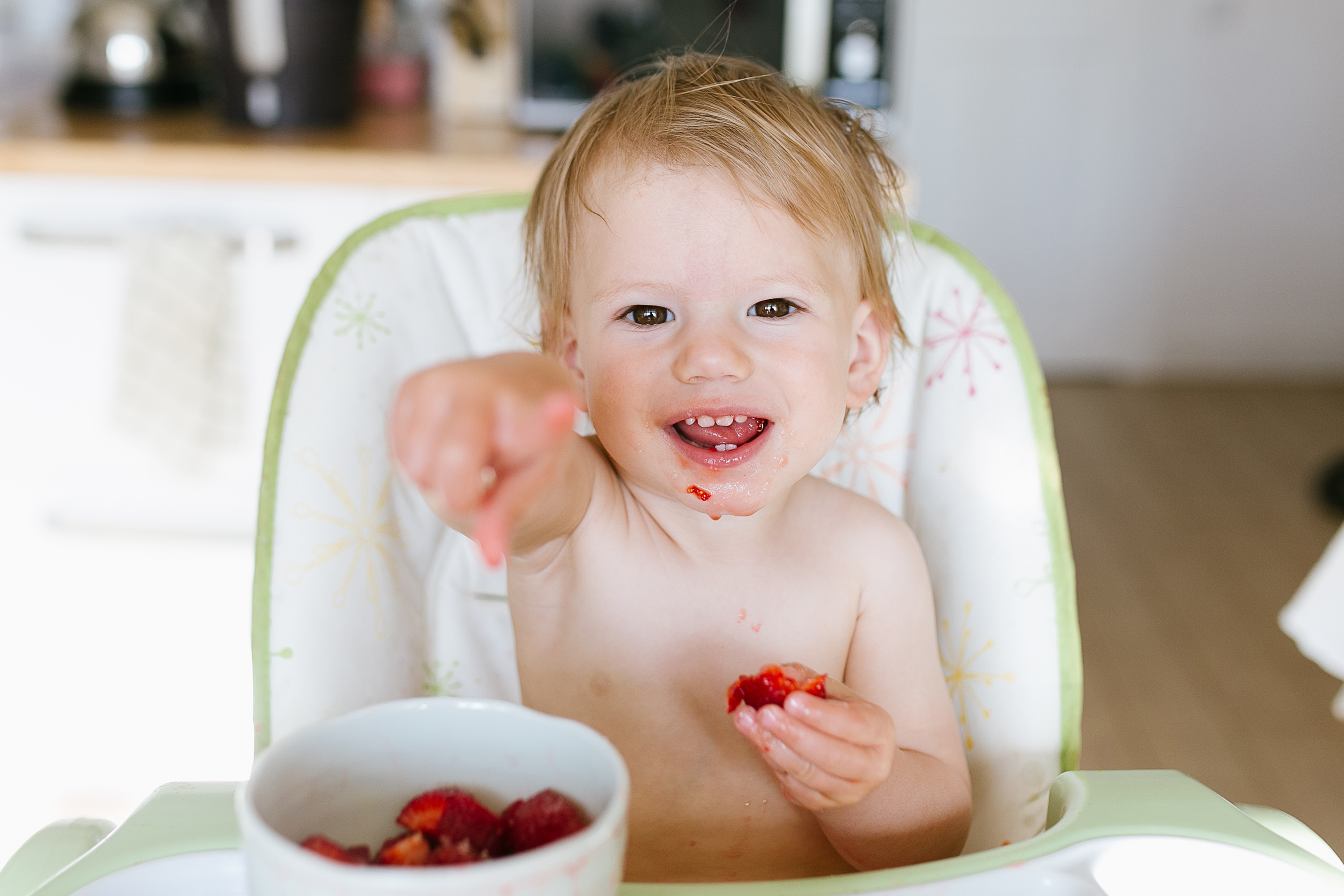 baby eating strawberries for baby led weaning